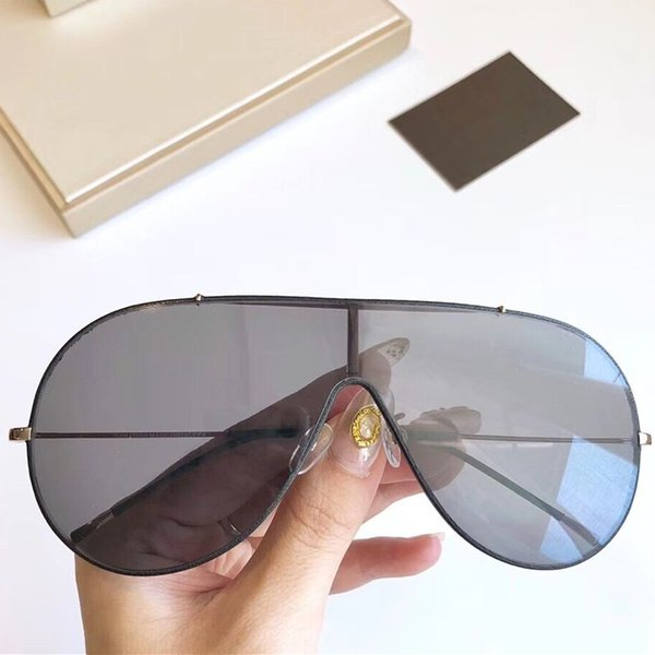 black gold grey lens