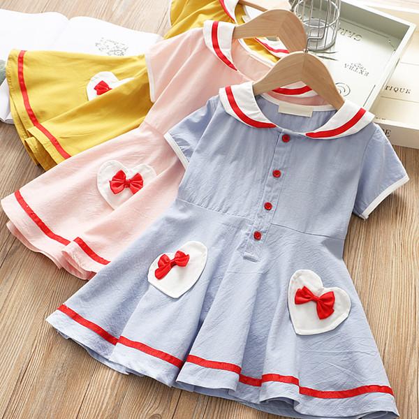 Escuela de Niñas Estilo Bow Heart Vestidos de bolsillo Verano 2019 Ropa de Boutique para niños 1-6T Niñas Vestidos de manga corta
