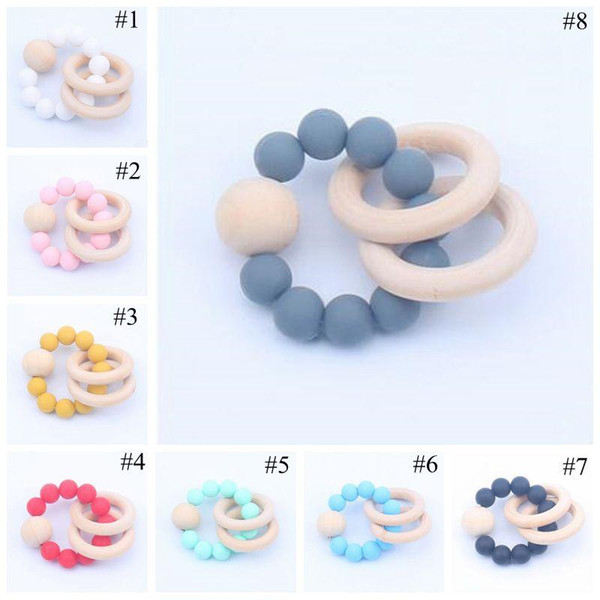 top popular Baby Teether Rings Food Grade Beech Wood Teething Ring Soothers Chew Toys Shower Play Chew Round Wooden Bead Newborn Silicone teether 2020