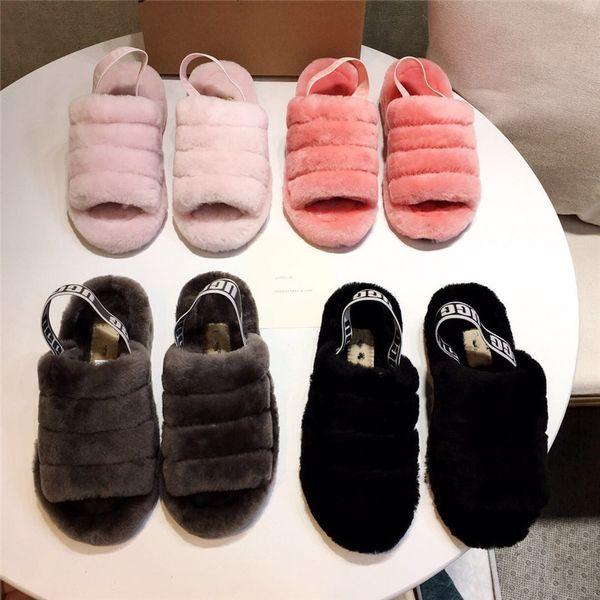 Slip unisex UG Botas Mujeres Hombres Diseño peludo zapatillas de piel diapositivas en los zapatos de los holgazanes Marca invierno de las señoras sandalias nieve Chunky Zapatilla de arranque C71908