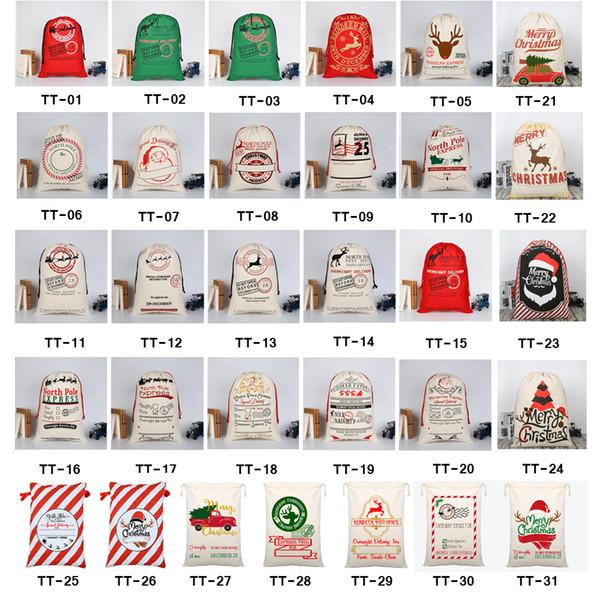 top popular 2020 Christmas Gift Bags Large Organic Heavy Canvas Bag Santa Sack Drawstring Bag With Reindeers Santa Claus Sack Bags for kids 2019