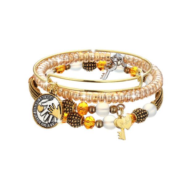 Miglior regalo d'oro Bead Big Hand Holding piccola mano chiave pesca ciondolo a cuore vestito Three-piece braccialetto europeo popolari americani femminile gioielli