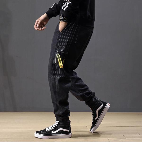 Japonés de la moda del Hombre Jeans Loose Fit empalmado Diseñador raya Harem Jeans Pantalones cargo de los hombres Streetwear Hip Hop del basculador