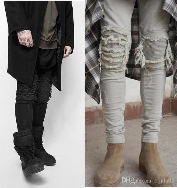 Estiramiento delgado pantalones rotos hasta la rodilla Metrosexual Pantalones vaqueros viejos Lápiz Pies Pantalones pitillo Mans marea pantalones de marca