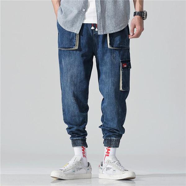 Pantalones vaqueros de varios bolsillos para hombres, estilo de primavera y verano, monos. Pantalones casuales de nueve centavos. Pantalones de hip hop holgados. Nueve pantalones.