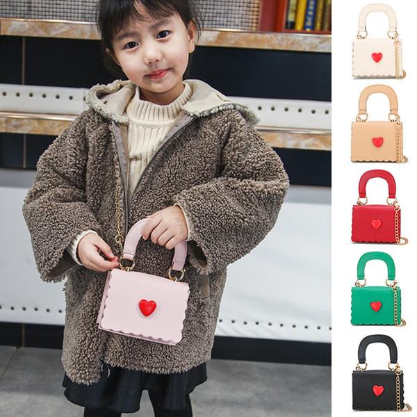 Bolsos de diseñador para niños 2019 Chicas coreanas Mini Princesa Monederos Cadena de la moda Bolsas cruzadas de cuerpo de alta calidad PU Bolsas de asas del corazón Regalos para niñas