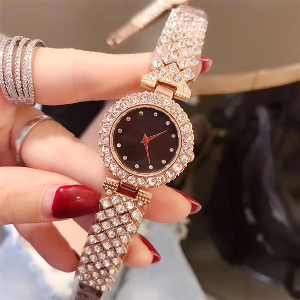 Le nuove donne di alta qualità di modo guardano l'orologio al quarzo della signora dell'acciaio inossidabile dei diamanti di lusso dell'oro / argento della rosa trasporto di goccia partito elegante piacevole