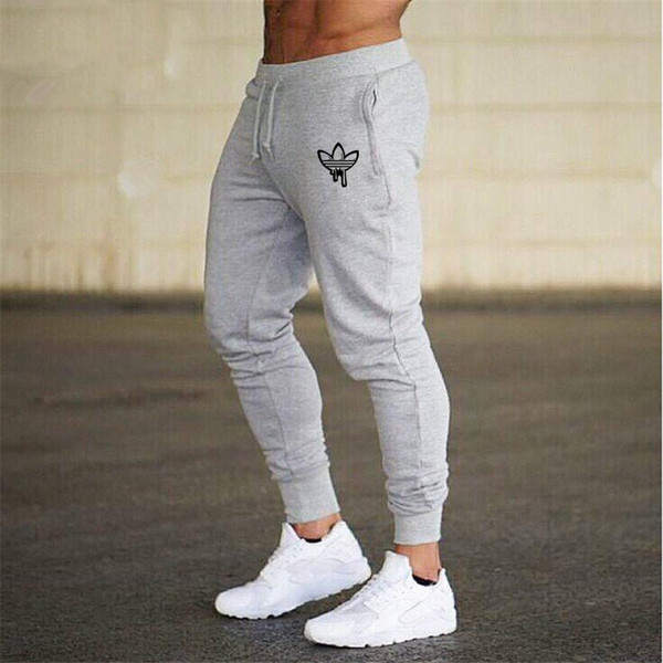 top popular Mens Joggers Pants Fitness Running Men Sportswear Gym Tracksuit Bottoms Skinny Sweatpants Trousers Homme Gyms Jogger Track Pants 2019
