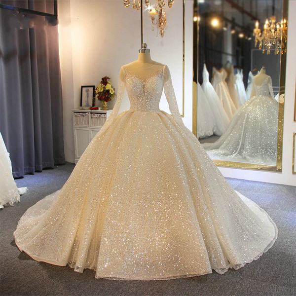 top popular Sparkling Ball Gown Wedding Dresses Sheer Jewel Neck Appliqued Sequins Long Sleeves Lace Bridal Gowns Custom Made Abiti Da Sposa 2021