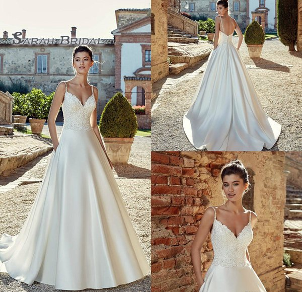 top popular 2019 Vintage Satin A-Line Bride Dress Sexy Backless Lace Beaded Ball Gown Evening Wear Formal Gown High-end Wedding Boutique 2020