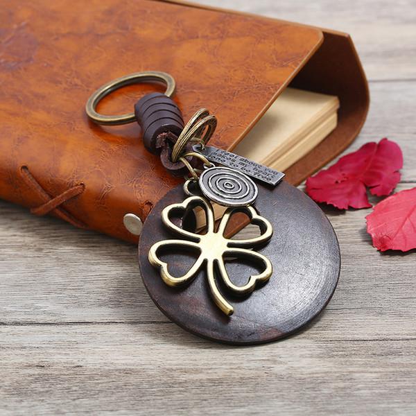 Nouveau trèfle à quatre feuilles pendentif en cuir alliage porte-clés de haute qualité rétro style punk porte-clés pour homme et femme livraison gratuite