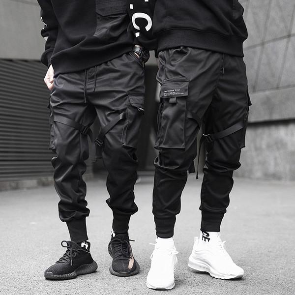 Hombres Cintas Color Block Pantalones cargo de bolsillo negros 2019 Harem Joggers Harajuku Sweatpant pantalones de hip hop