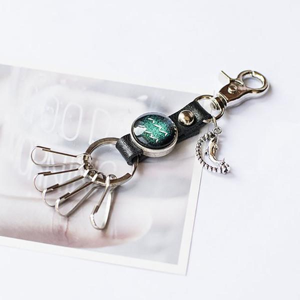 Newest Brand Man Key Buckle Twelve Constellation Moonlight Jewel Key Chain Manual Book System Rotating Dolphin