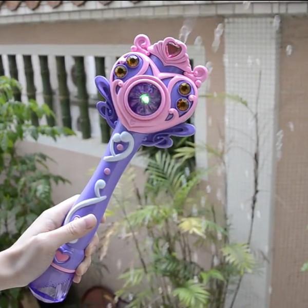 Nueva moda completamente automática máquina de burbujas Magic Wand Bubble Gun Toy Bubble con música y regalo de cumpleaños de la fiesta de los niños ligeros