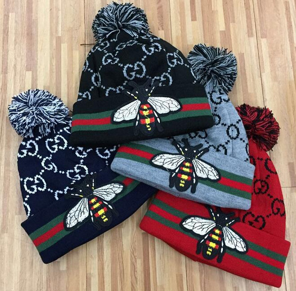 Top brand High quality Red snake men fashion knitted hat classical sports skull caps Female outdoor goose bee Women beanies