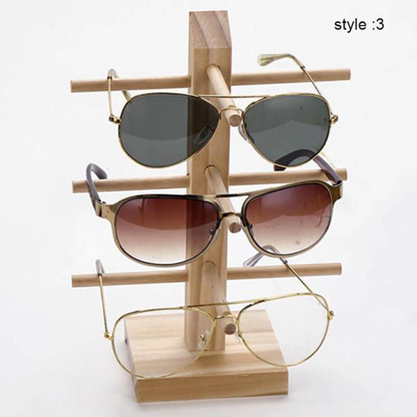 купить оптом недавно 1 шт деревянные солнцезащитные очки стойки полки деревянные прочные очки держатель выставки стенд отsara001 в категории гараж