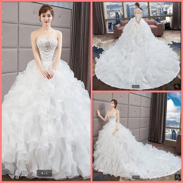 2019 free shipping organza ball gown ruffled wedding dress heavily beading sparkly strapless chapel train bride gowns wedding dress hot sale