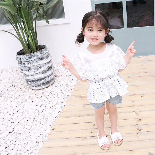 Bebé camisa de algodón blanco puro Niños de encaje hueco manga corta camisa con volantes verano nuevos modelos niñas Wawa Shan princesa ropa