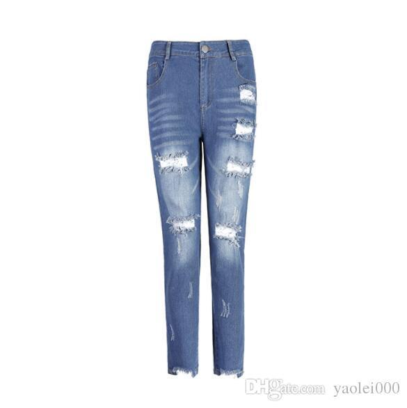 Europe and America ladies cotton jeans sexy hips ladies jeans hole feet in the waist jeans pants black blue
