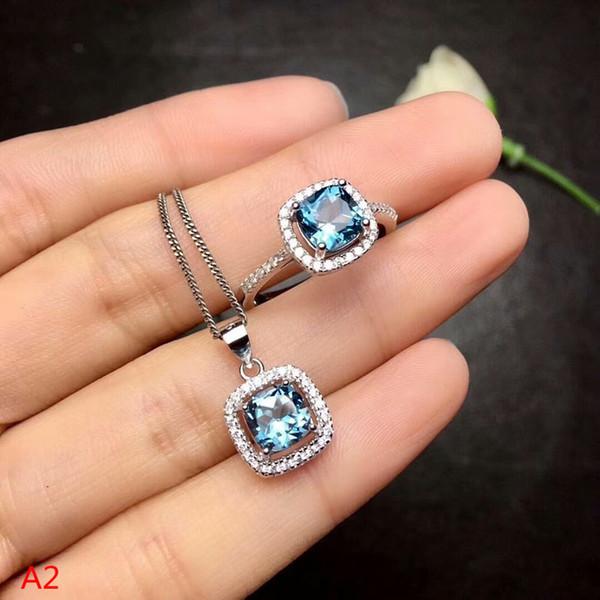 KJJEAXCMY boutique Gioielli 925 puro argento intarsiato topazio blu Pendente + Necklace + anello set di gioielli signore.