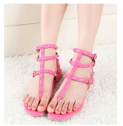 top popular 2019 Color Rivets Spiked Gladiator Flat Sandals Stones Studded Flip Sandal Big Size Designer Women's Cheap Shoes Summer 2020