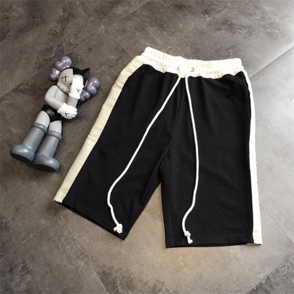 American Street Matching Pantalones cortos para hombre Pantalones cortos con cordones planos relajados Verano Longitud de la rodilla Diseñador Pantalones cortos