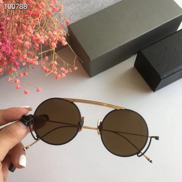 oro negro con lente marron