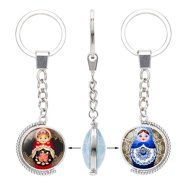Neue Matryoshka doppelseitige drehbare Schlüsselanhänger Glas Cabochon Tradition russische Puppe Schlüsselanhänger Ring Modeschmuck Zubehör