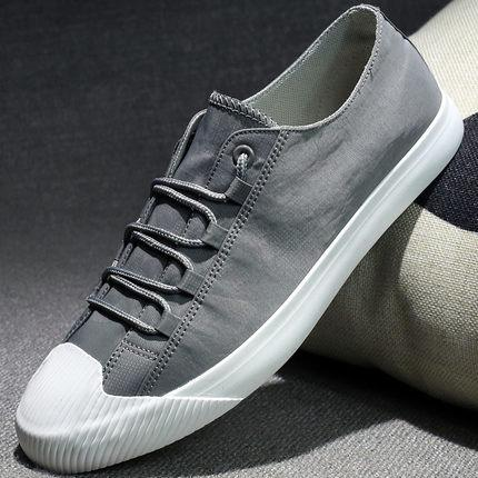 Flat sole design of man's breathable and wear-resistant canvas plain-color casual shoes in summer of 2019