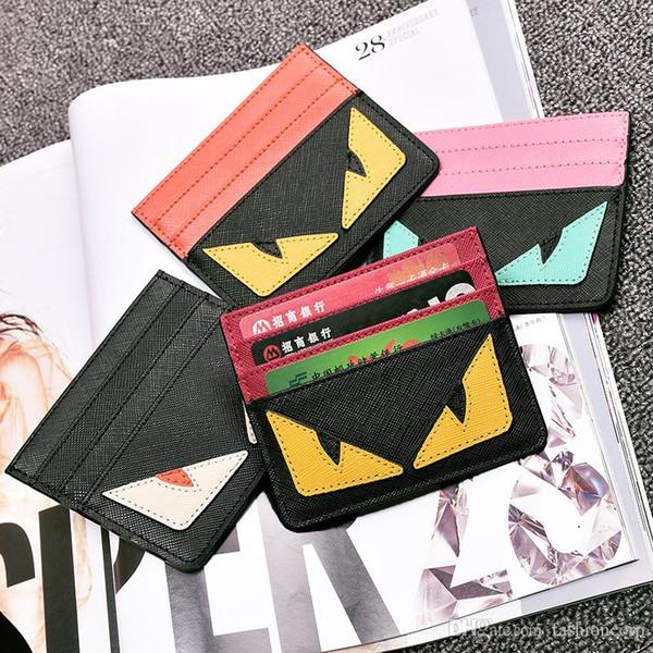 Ultra Thin New Genuine Leather Card Holder Wallet Diablo Ojos Diseño lindo Little Wallet para Hombres Mujeres Tarjetas de crédito