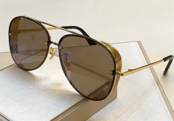 cadre d'or lentille de brun