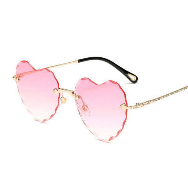 Moda sin montura gafas de sol de las mujeres recién llegado en forma de corazón amor gafas mujer buena calidad gafas de sol UV400 viajes de compras