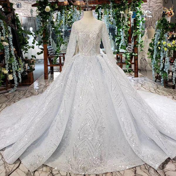 2019 Latest Bohemian Wedding Dresses Long Tulle Sleeve Open Keyhole Back Illusion Neckline Sequins Pattern Applique Bridal Gowns Garden