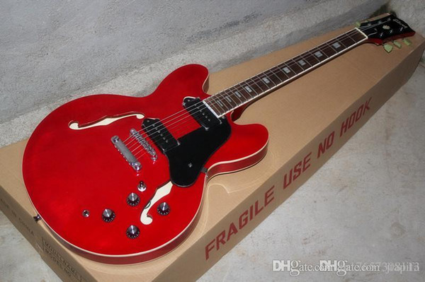 La guitarra de jazz roja ES-335 media hueca doble hueca f-hole