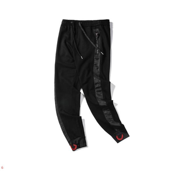Diseñador de moda para hombre Pantalones de lujo para hombre Pantalones con patrón de rayas Jogging Pantalones de chándal Pantalones de marca Ropa M-2XL al por mayor