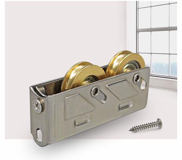 top popular 80 type window roller sliding door plastic steel window pulley Aluminum alloy doors and windows wheel mute brass wheel hardware 2021