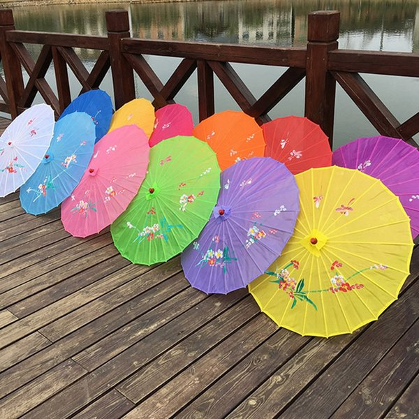 top popular Adults Chinese Handmade Fabric Umbrella Fashion Travel Candy Color Oriental Parasol Umbrella Wedding Party Decoration Tools TTA1790 2021