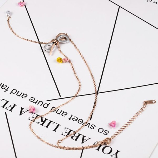 Fashion crystal titanium steel bow necklace with tassel collarbone chain