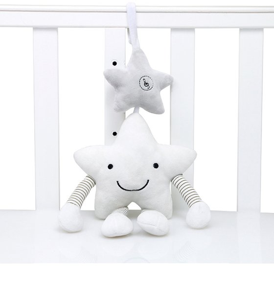 A estrela branca branca dos carrilhões de vento móveis do luxuoso acompanha o brinquedo que pendura no presente da cama para bebês