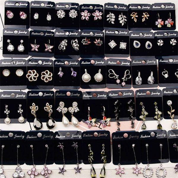 Venta al por mayor de pendientes de moda con una geometría exquisita y Pendientes decorativos con aretes y pendientes de circonitas con pendientes de cristal T5C6012