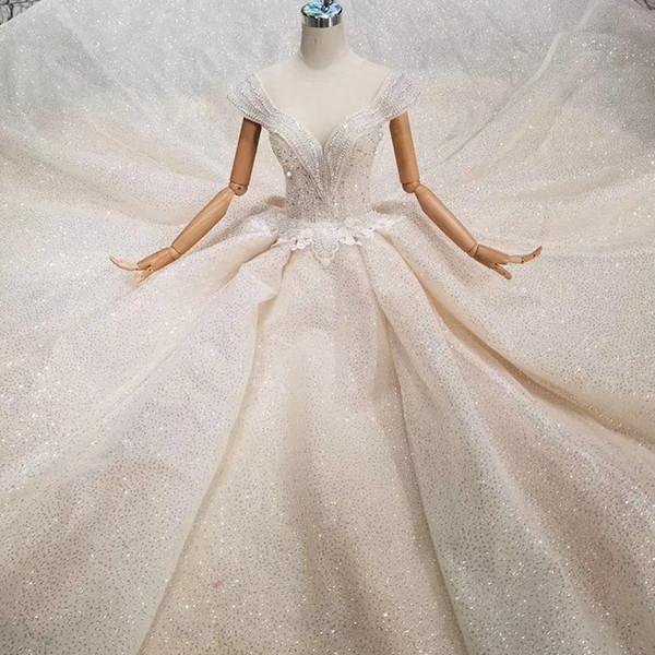 Vestido de novia especial de alta calidad Cristal Cap Manga Ilusión O-cuello Hecho a mano Con cuentas Vestido de novia Transparente Volver Nuevo Diseño de moda