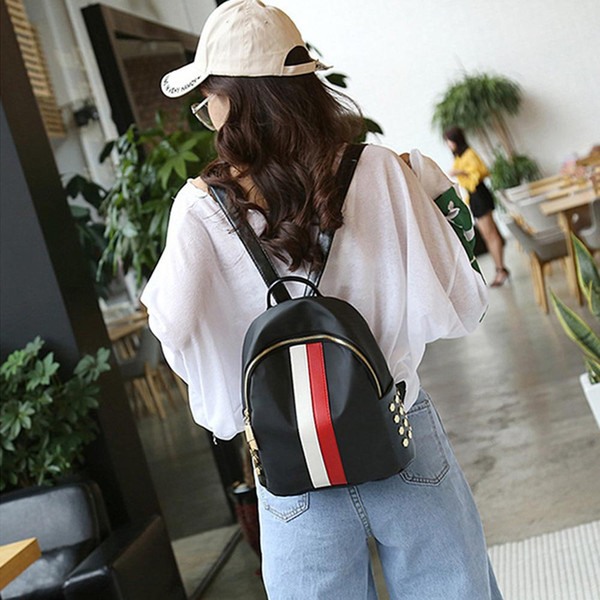 New women's casual travel portable fashion personality simple rivets Striped zipper Oxford cloth waterproof shoulder bag