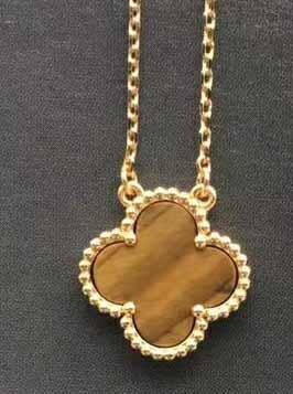 ожерелье из золота и тигрового камня