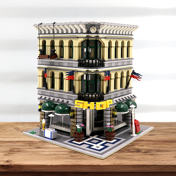 top popular In stock 10211 Creator Grand Emporium 15005 2232Pcs Street View Model Building Blocks Bricks Education Toys Christmas gifts 2021