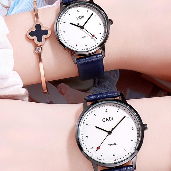 Regarder Couple 2019 version coréenne de la table de couple tendance Harajuku Casual Wind Belt Wrist Watch Montre simple personnalité montre féminine