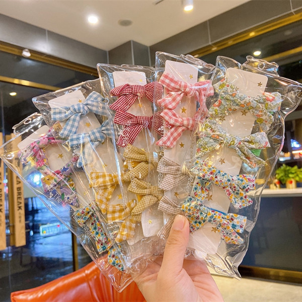 top popular Plaid floral children's issuing issuing card clip girl's sweet hair accessories all-match cute children's striped hair card cover 2021