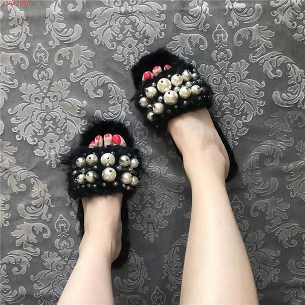 Señora de otoño e invierno zapatillas de felpa para el año 2019, con incrustaciones de perlas suaves zapatillas planas cómodas para las señoras con tamaño de la caja 34-40