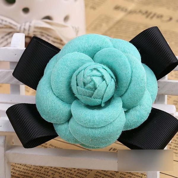 Turq Wool Bow