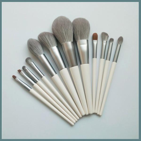 2019 de alta calidad de Amazon venta caliente 12 UNIDS pelo gris logotipo personalizado pincel de maquillaje conjunto con bolso opp