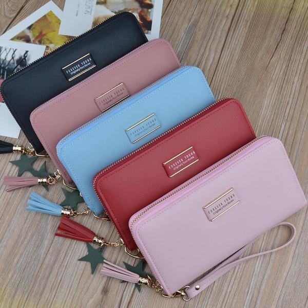 2020 Fábrica al por mayor de la marca de mano de cuero billetera coreana de gran capacidad de la moda de la borla de cuero larga cartera color del caramelo de la mano billetera 2019